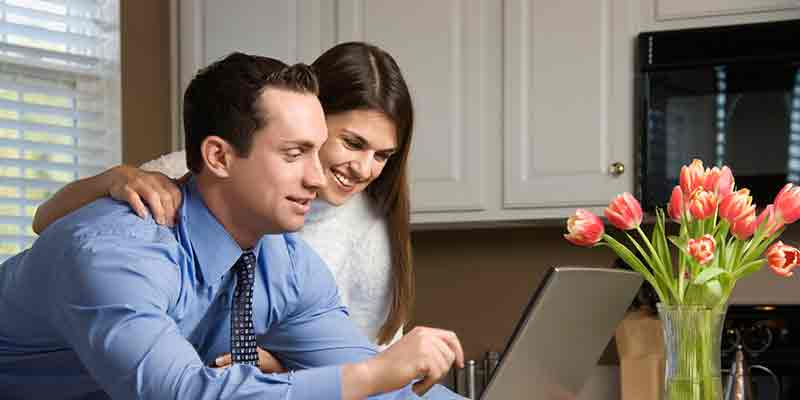 couple in a front of computer